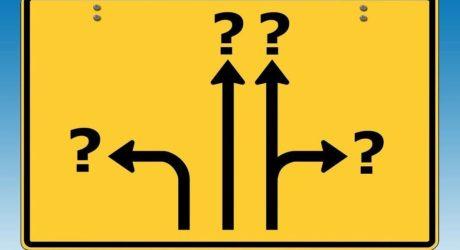 Żółty znak ze strzałkami